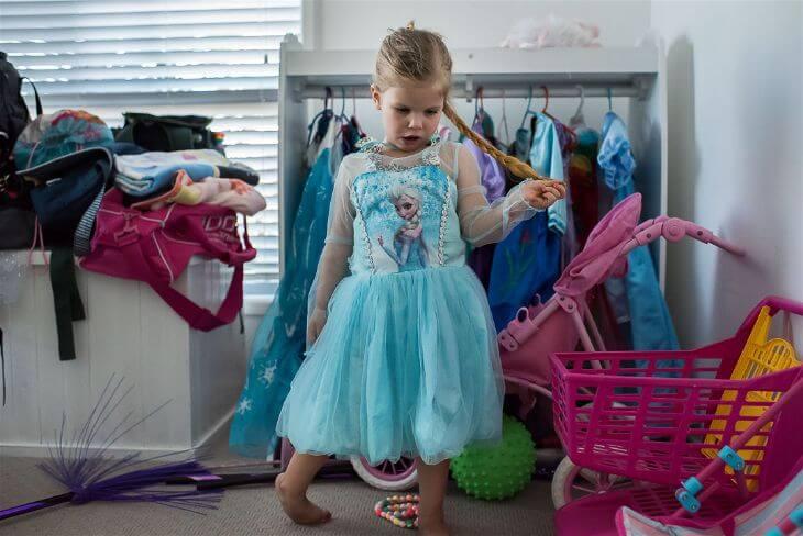 """Little girl posing in her """"Frozen"""" costume."""