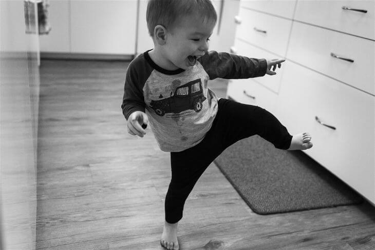 Little boy kicking the air in the dance.