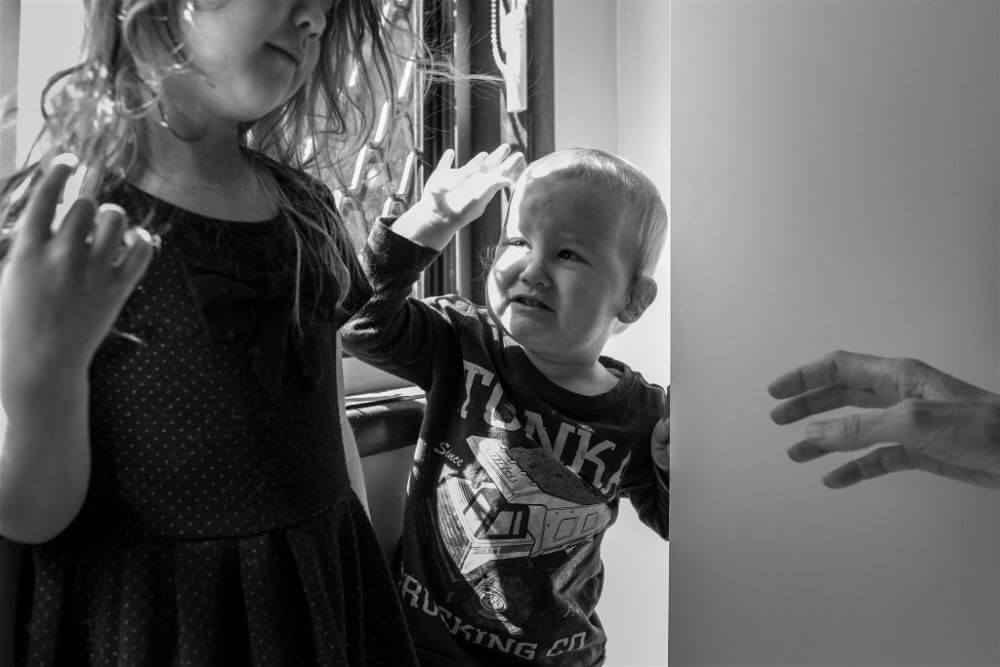 Siblings fight at documentary family photography session